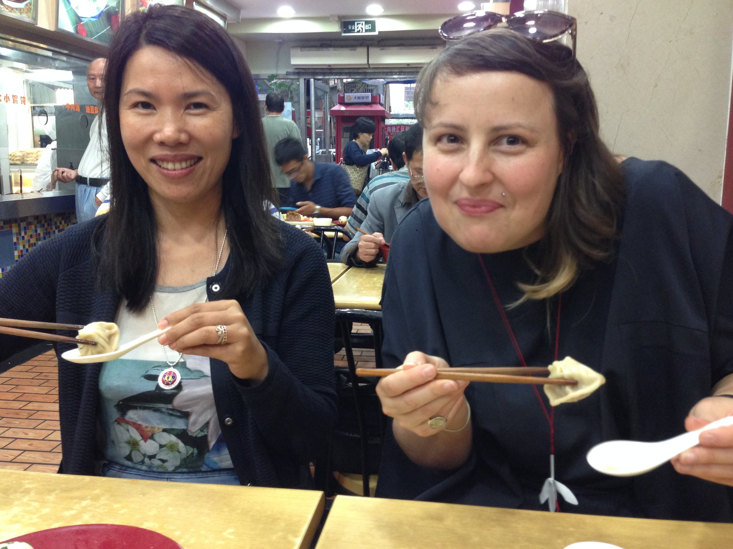 Yiwei and Jess enjoy yummy dumplings in Shanghai
