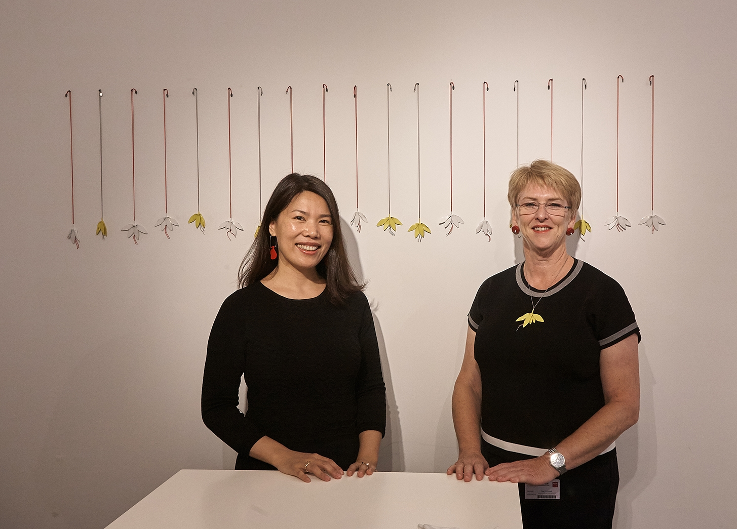 Yiwei Wu and Rae O'Connell with the work of Jess Dare