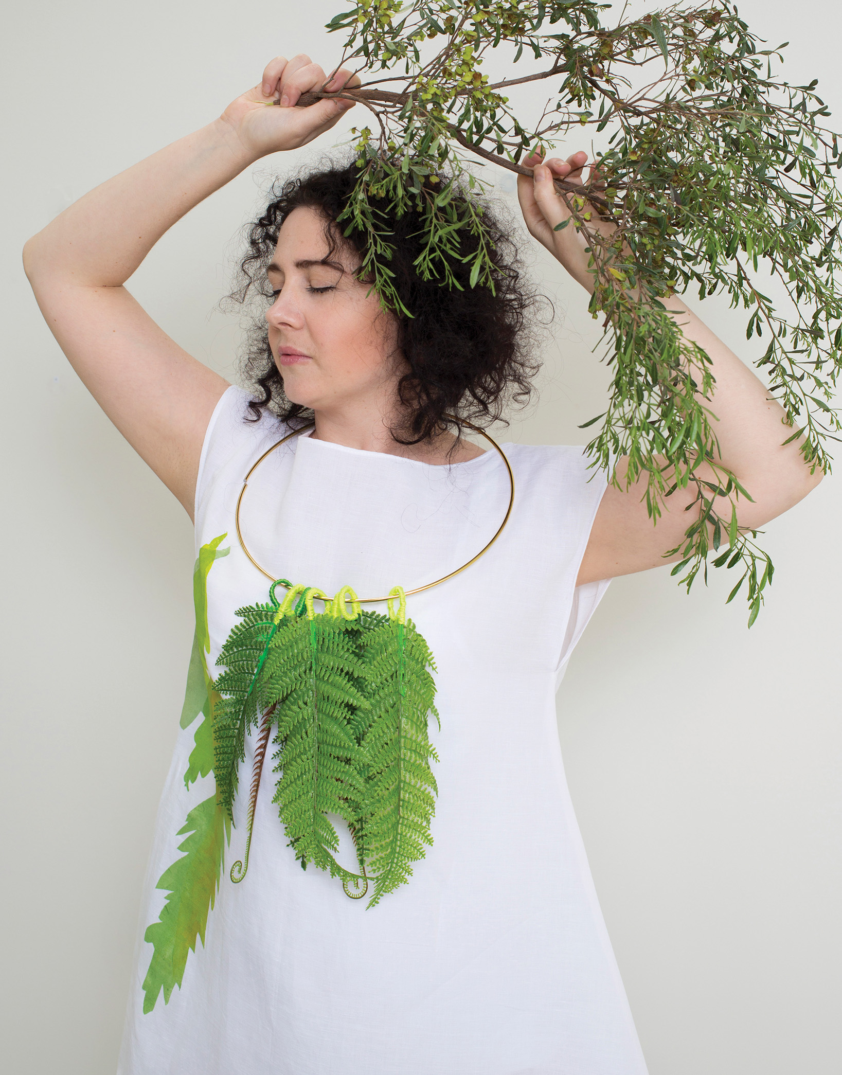 Fern lei  2017, artificial foliage, metal ring, thread, paint.  Fern dress  2017, short white linen-cotton, hand cut stencil print, one-off . Photographed by Craig Arnold