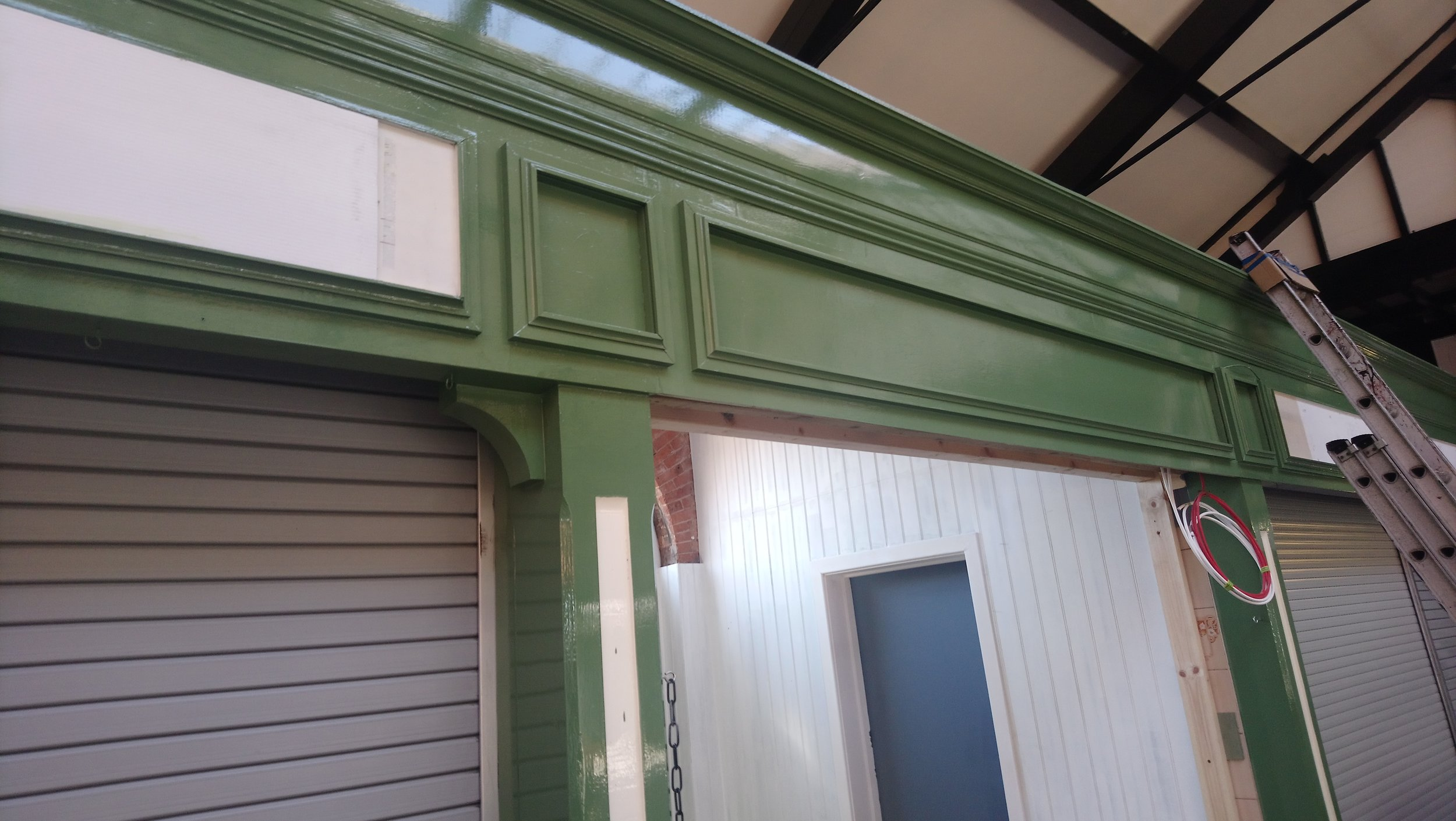 Week 7 - It is all coming together and the internal decorations are progressing nicely. The external of the Market Hall units are nearly complete while the undercoat for the central stalls has been applied.
