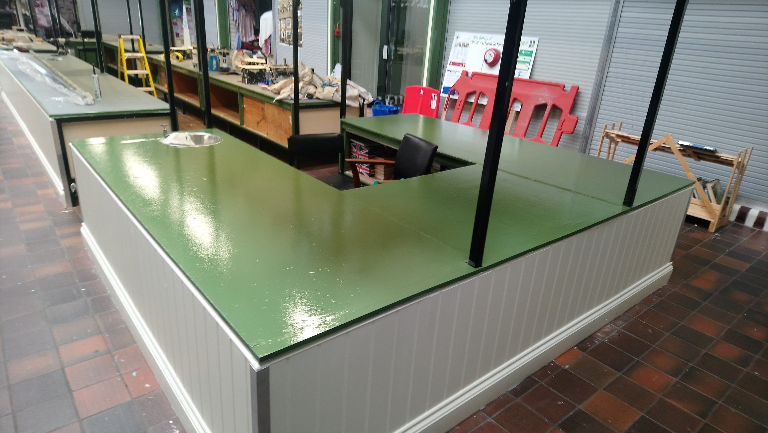 Week 8 - The last week of works in the Market Hall. First of the table tops decorated and complete.