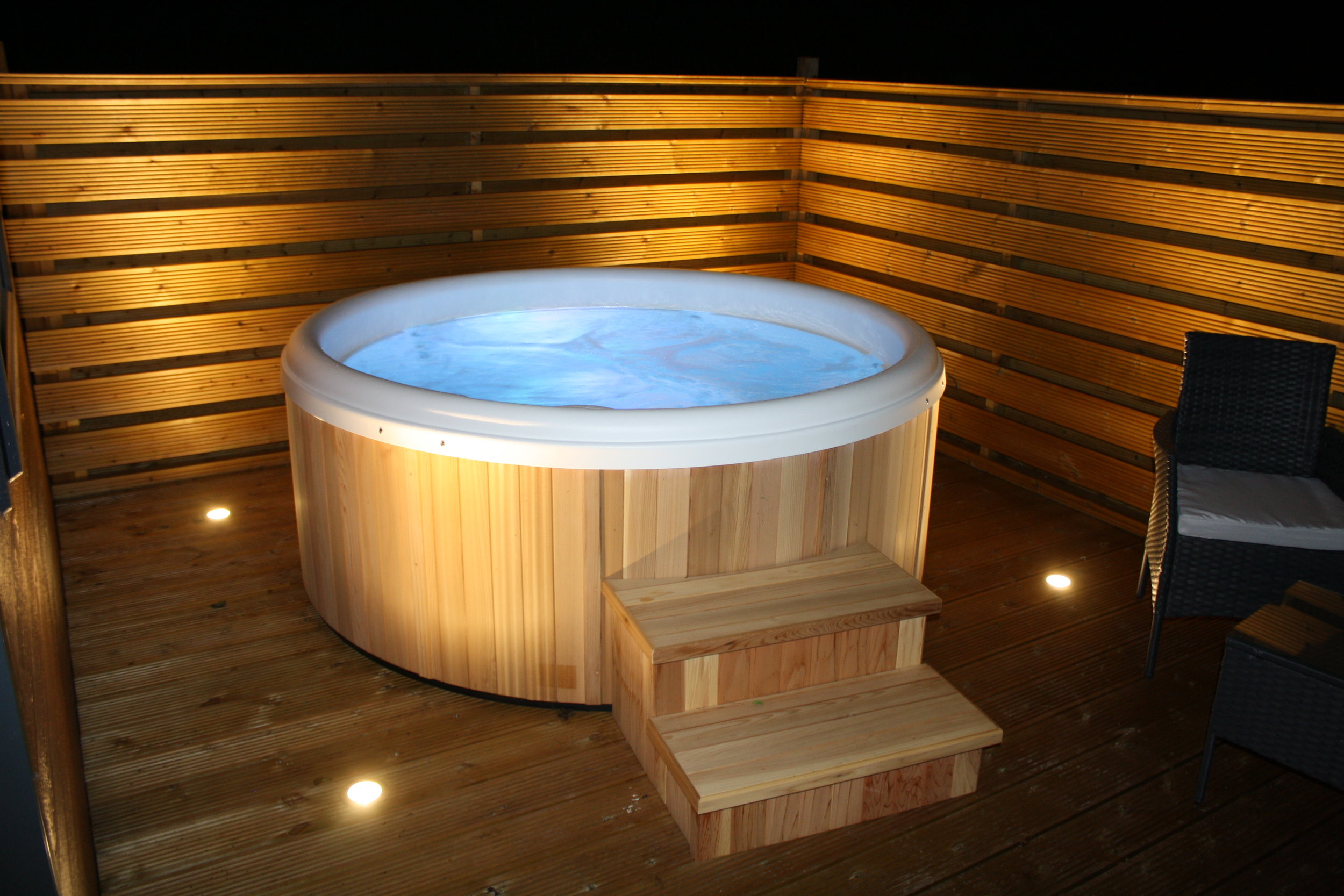 the hot tubs - These hot tubs are fab... From the urban cedar hot tub company they are perfect for 2 people to relax, the jets can be adjusted to suit your needs and they display many different colours..Each cabin has a hot tub which is solely for your use.. whether you like a late night soak or early morning wake up they are the perfect tool to help you relaxSited to the side of the cabin to give you maximum privacy yet offing fabulous views over the lake!