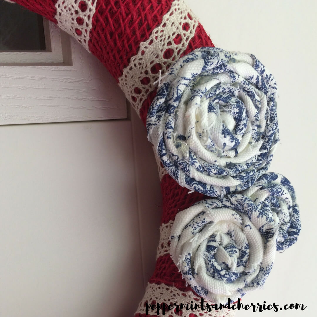 Red White and Blue Farmhouse Décor A Patriotic Wreath Tutorial Dollar Store Craft Challenge www.peppermintsandcherries.com #farmhousedecor #farmhousestyle #patrioticdecor #redwhiteandblue #wreaths