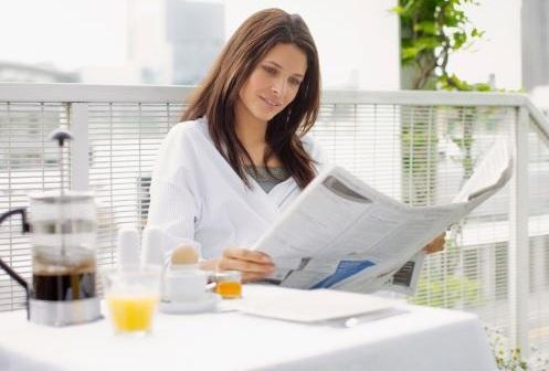GettyImages-107429972+breakfast+woman+reading+newspaper+small.jpg