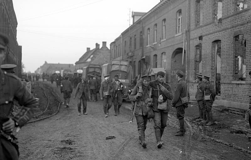 Wounded British troops returning through Vermelles after the attack on Hohenzollern Redoubt, 13th October 1915.