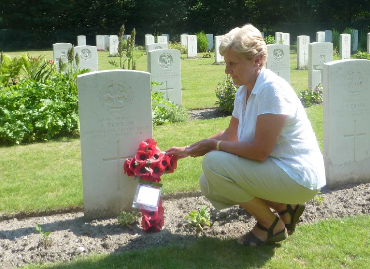 Annette Martin (née Leighton) – the daughter of James Penton Leighton, granddaughter of the Penton brothers' sister Alice Penton (born 1892) – laying a wreath on the grave of Jim Penton in 2010.