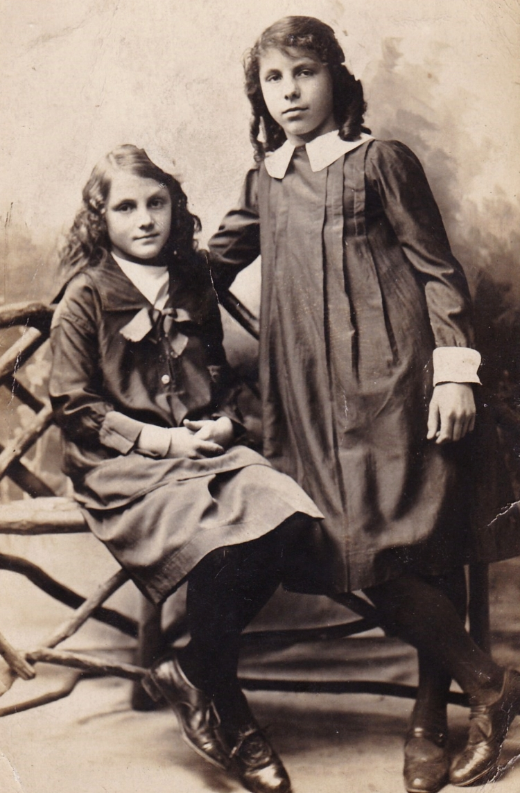 Florence 'Florie' Penton (standing) with her younger sister Beatrice