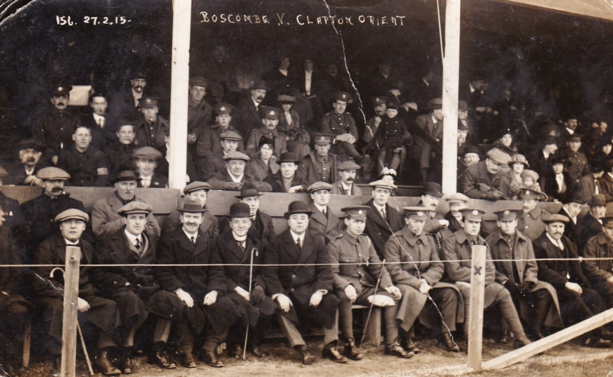 Private James Penton front row 4th from right of picture watching the football game between Boscombe and Clapton Orient (now Leyton Orient) on 27 February 1915