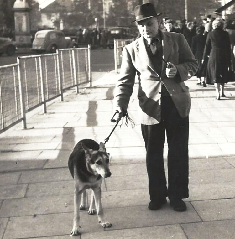 Harry Penton and his Alsatian dog 'Peg' in Cannock Town Centre in the 1950s