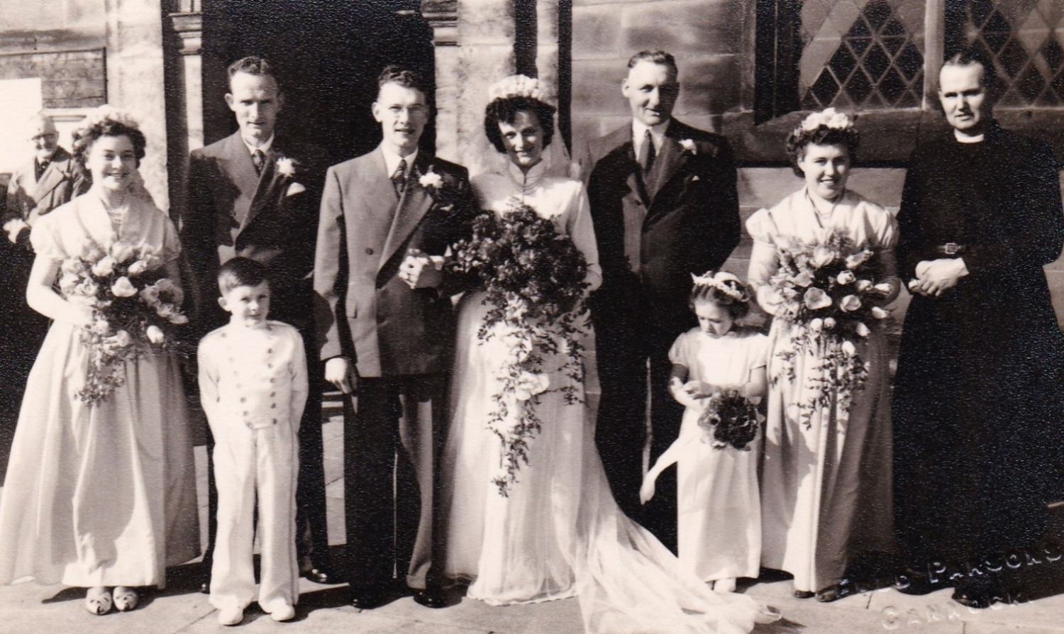 The wedding of John 'Jack' Brough & Daisy Iris Penton in 1952. Daisy's father, Charlie Penton is standing next to the bride. Her brother, James Henry 'Jim' Penton was best man and is standing next to the groom.