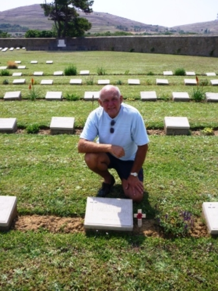 Alan Betts visiting the grave of 15076 Private Joseph Edward Barnett in East Mudros Military Cemetery.