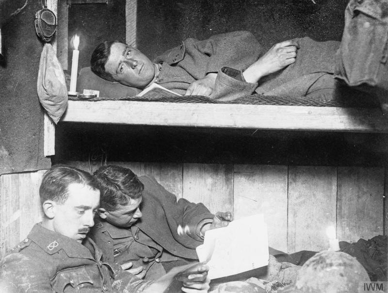 Officers of the South Staffordshire Regiment studying a trench map in a captured German dug-out beneath the ruined church at Beaumont Hamel in November 1916.