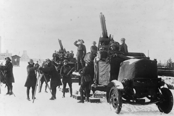 Mobile anti-aircraft guns – mounted on Thornycroft lorries – in action at Armentières on 28 December 1917