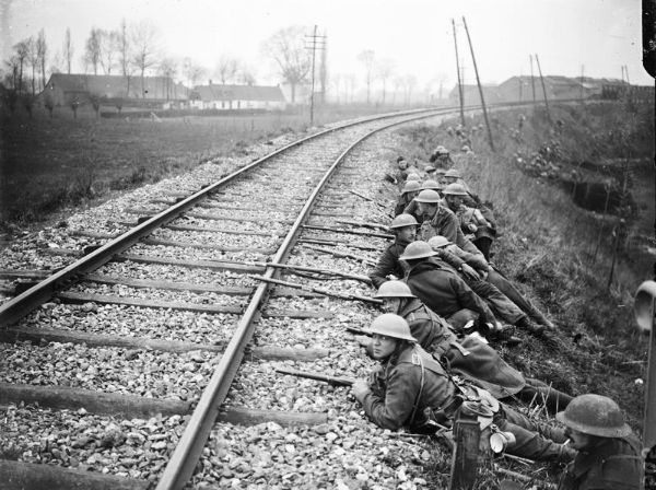 British troops forming a line of defence beside a Merville railway track, 11 April 1918.