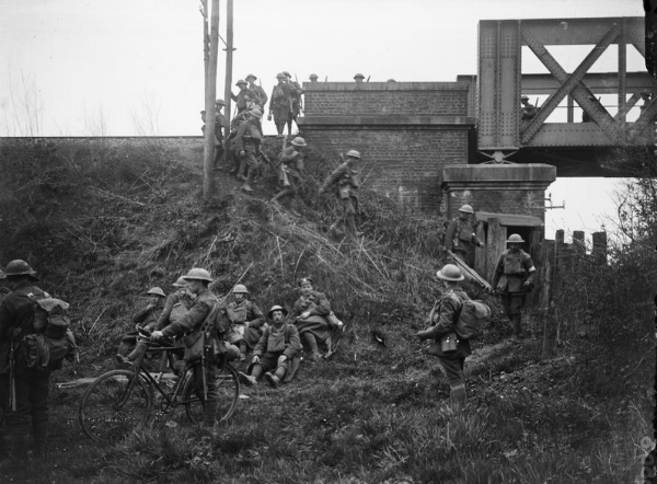British troops reaching a Merville railway embankment that they have been sent to defend, 11 April 1918.