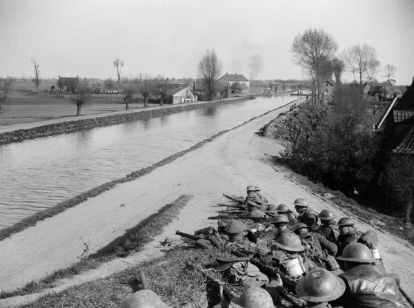 British infantry troops holding a line of defence along the canal near Merville, 12 April 1918.
