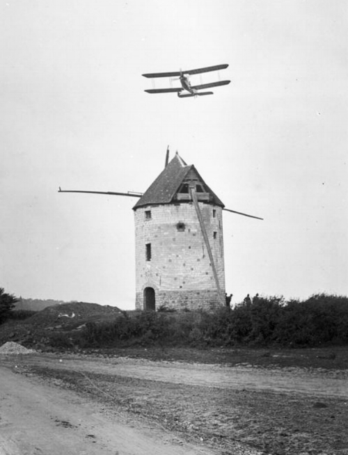 Royal Flying Corps biplane flying over the mill at Fienvillers in 1916