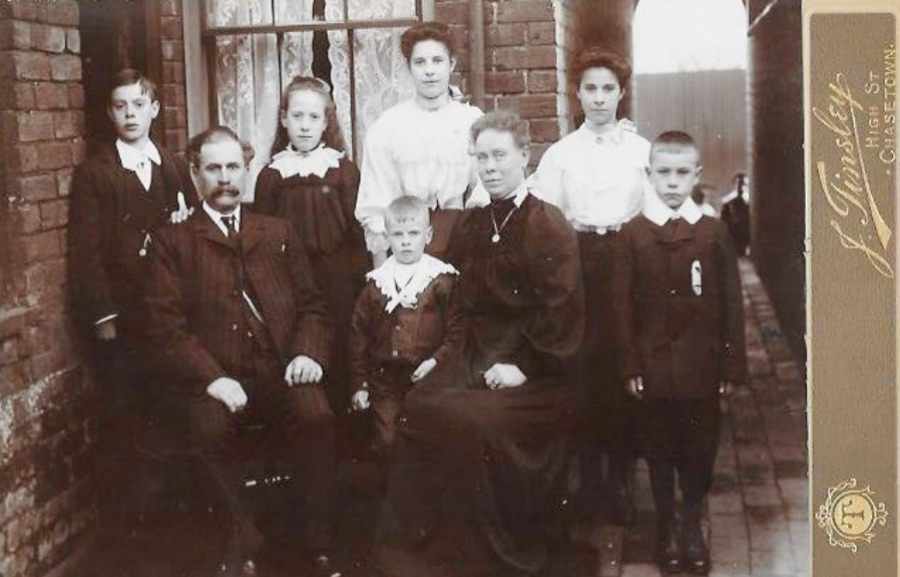 The Daker Family living at 2 New Street, Chasetown. From left to right: Back Row: James, Mary, Maud, Phoebe Front Row: William Jude, Harold, Phoebe Sarah, William