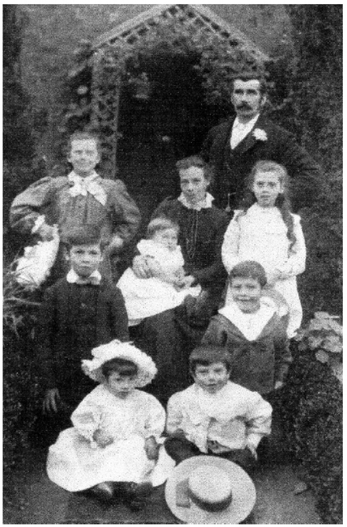 Photograph of Reice and Sarah with their family