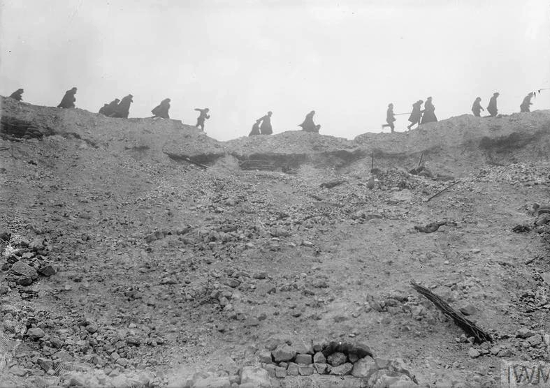 British troops running along the lip of the Lochnagar mine crater at La Boisselle, 23rd October 1916