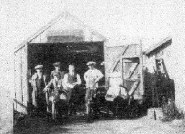 Frederick's garage partnership with his brothers, Len and Harold. The garage acted as an agent for Raleigh, Ariel and Royal cycles. Frederick is on the left in this photograph.