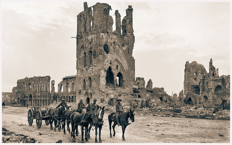 A loaded limber passing the ruins of the Cloth Hall at Ypres, 14 September 1917
