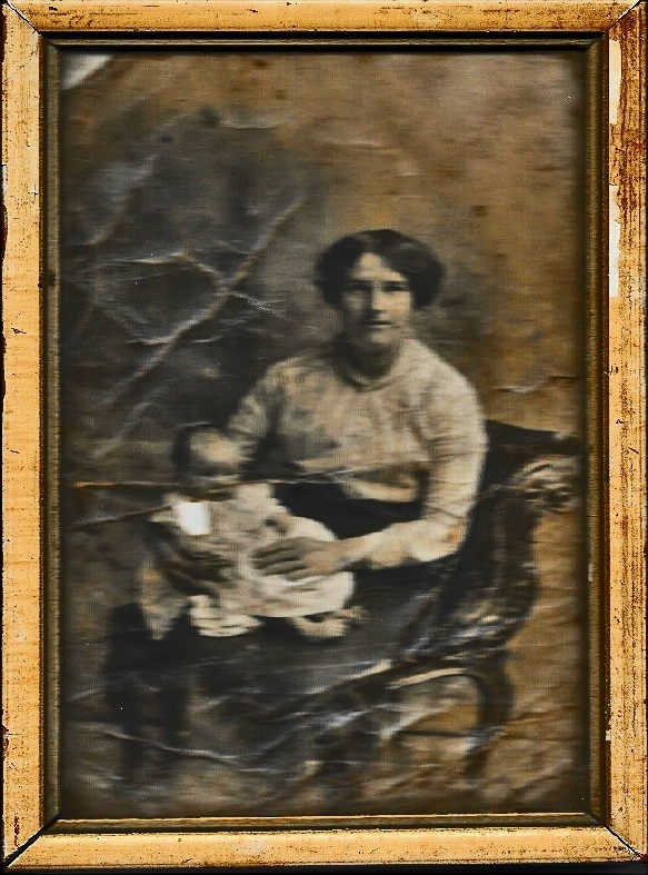 Photograph of George Henry Watts' wife Mary Ellen Watts with their nine month old daughter Mary Ellen. The photograph was found on the battlefield and returned to the family.