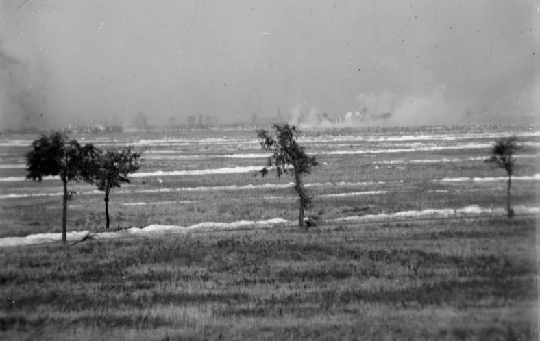 Photograph taken during the Battle of Loos showing British troops (in the top right corner of the picture) advancing towards Hohenzollern Redoubt, which is located behind the gas clouds.