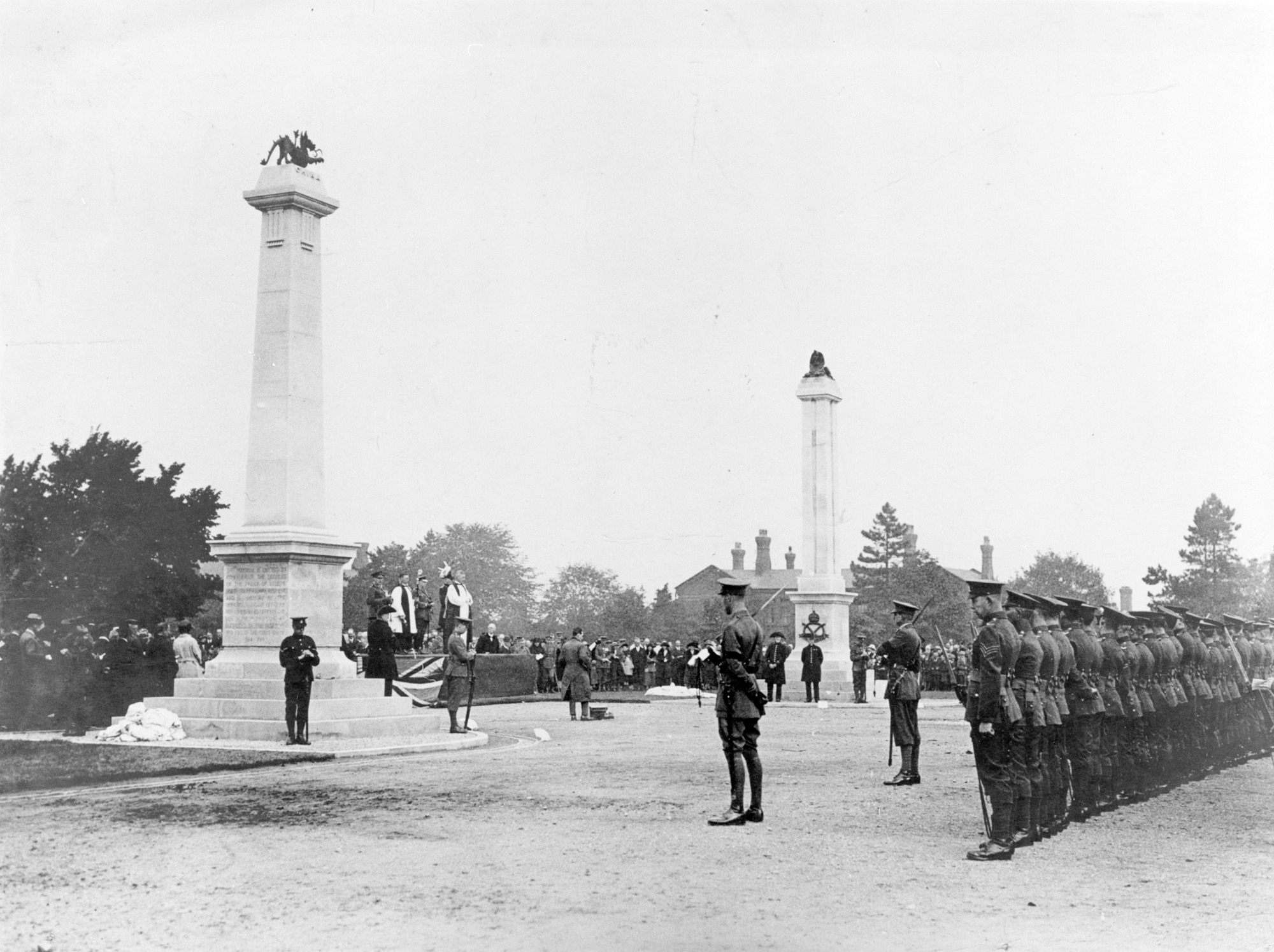 Photograph of the unveiling and dedication of the war memorials on 30 September 1922. On the left is the memorial to the North Staffordshire Regiment (surmounted by a Chinese Dragon); on the right is the memorial to the South Staffordshire Regiment (surmounted by a Sphinx).