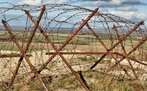 Chevaux de frise {knife-rests as they were known by the British} were barbed wire defences prepared behind the lines and brought forward and put in place at night.