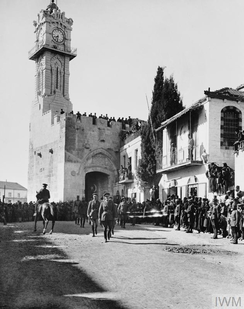 Photograph of Lieutenant General Sir Edmund Allenby entering the city of Jerusalem. He is seen walking through the Jaffa Gate at noon on 11 December 1917. Allenby went on foot out of respect for the Holy City.