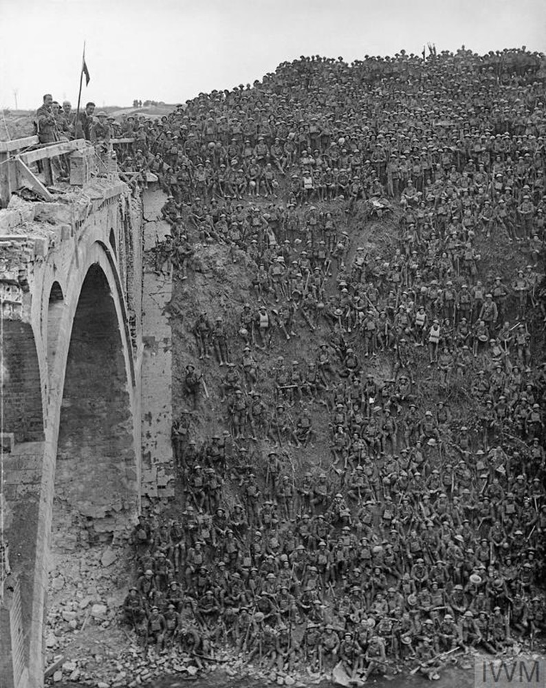 Photograph, taken on 2 October 1918, of Brigadier-General John Vaughan Campbell V.C. on the Riqueval Bridge over the St. Quentin Canal addressing the men of the 137th Brigade (46th Division) who had captured and crossed the Canal on 29 September 1918.