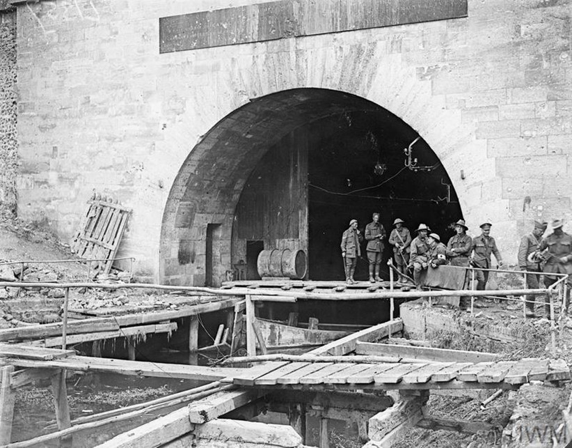 Photograph showing soldiers of the 30th American Infantry Division and 15th Australian Brigade (5th Australian Division) at the southern entrance at Riqueval of the Bellenglise to Bellicourt Tunnel, captured by 1/6th South Staffords on 29th September 1918.