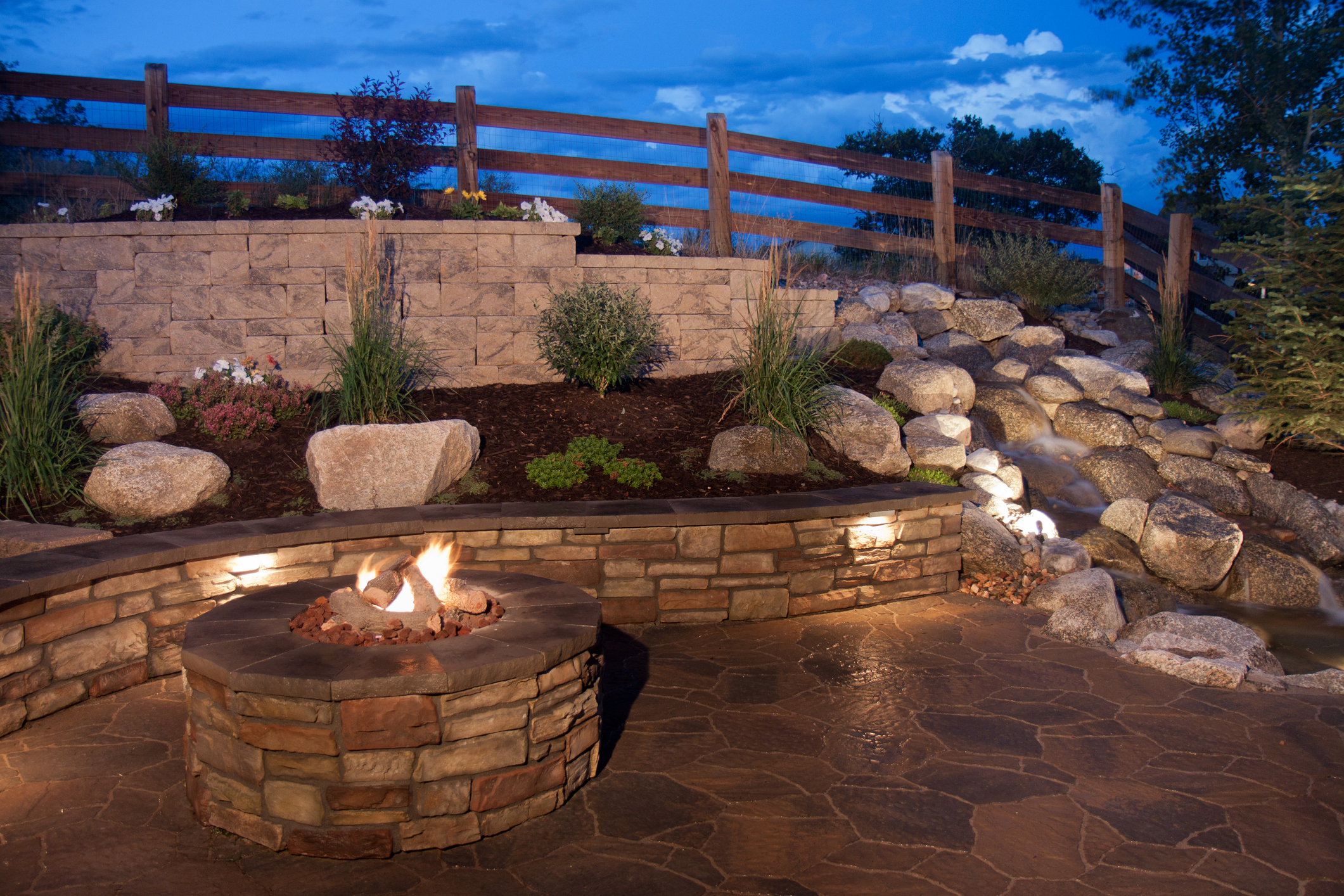 Landscape Lighting - Landscape lighting can create a cozy or modern ambiance with the simplicity of installing a few small lights either under a ledge or in a garden bed. You can give your backyard an elevated appeal with this simple and elegant touch.