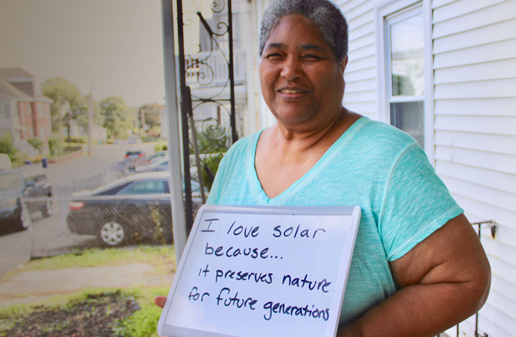Boston resident and climate leader Olive Knight got solar panels installed on her roof at no cost through the Solar Access Program, financed by Sunwealth in partnership with local developer Resonant Energy. (Photo courtesy of Resonant Energy)