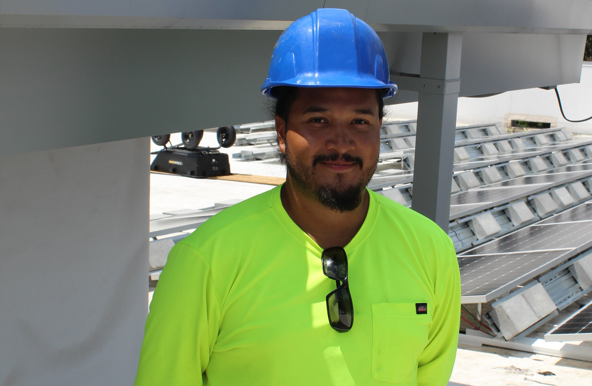 Raul Urzua, a member of the CTEC Solar crew, takes a break from installing solar panels at the Whole Foods Market Sudbury.