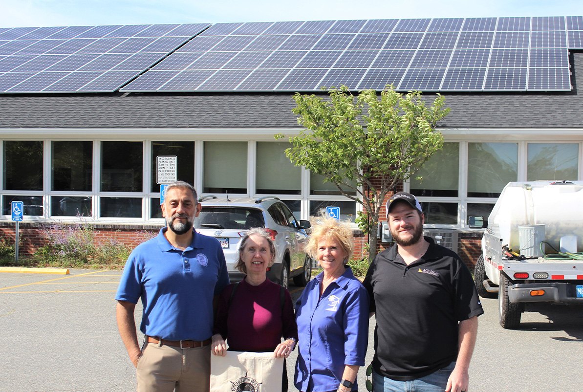 David Gardner (Town of Provincetown), Lydia Hamnquist (Provincetown Renewable Energy Committee), Liz Argo (Cape & Vineyard Electric Cooperative), and Casey Bolduc (ACE Solar) pose for a photo in front of the Provincetown Community Center.