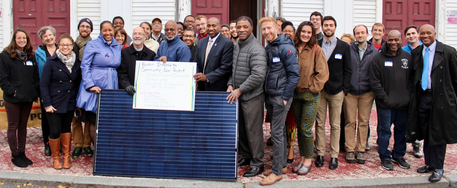 Community members and stakeholders gather at the Second Church in Dorchester to celebrate the Interfaith Solar Project. Through the project, Boston Impact Initiative supported solar installations on the rooftops of three Boston churches in majority non-white neighborhoods.