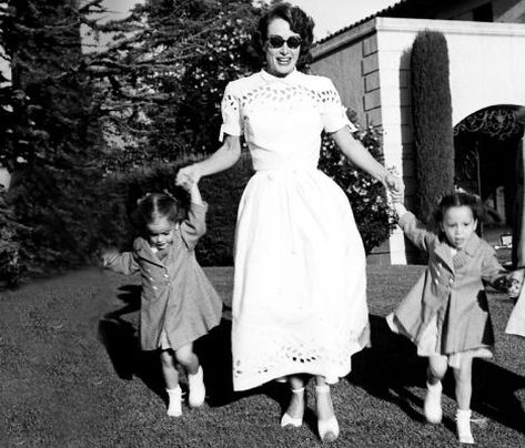 Joan Crawford with daughters Cathy and Cynthia