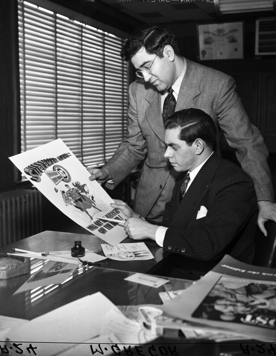 Siegel and Shuster at desk.jpg