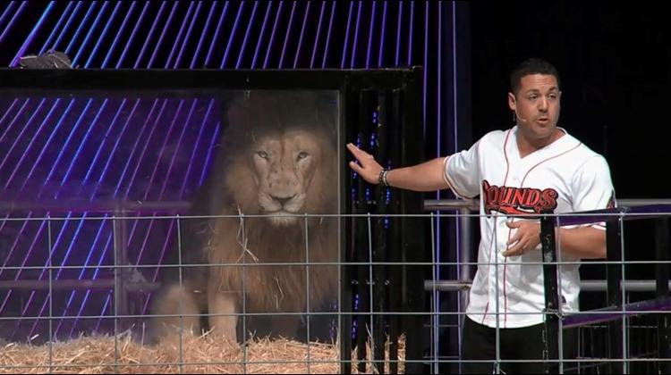 Galen Davis and a lion at a church service