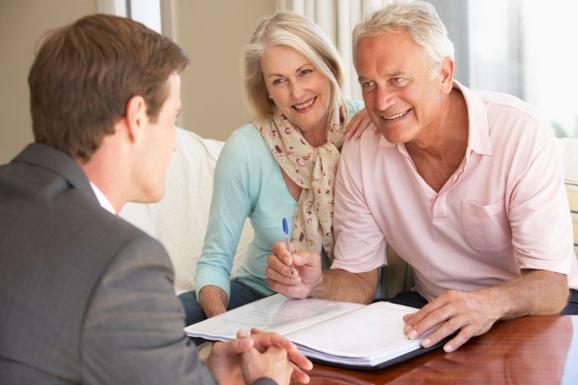 senior-couple-with-financial-advisor.jpg