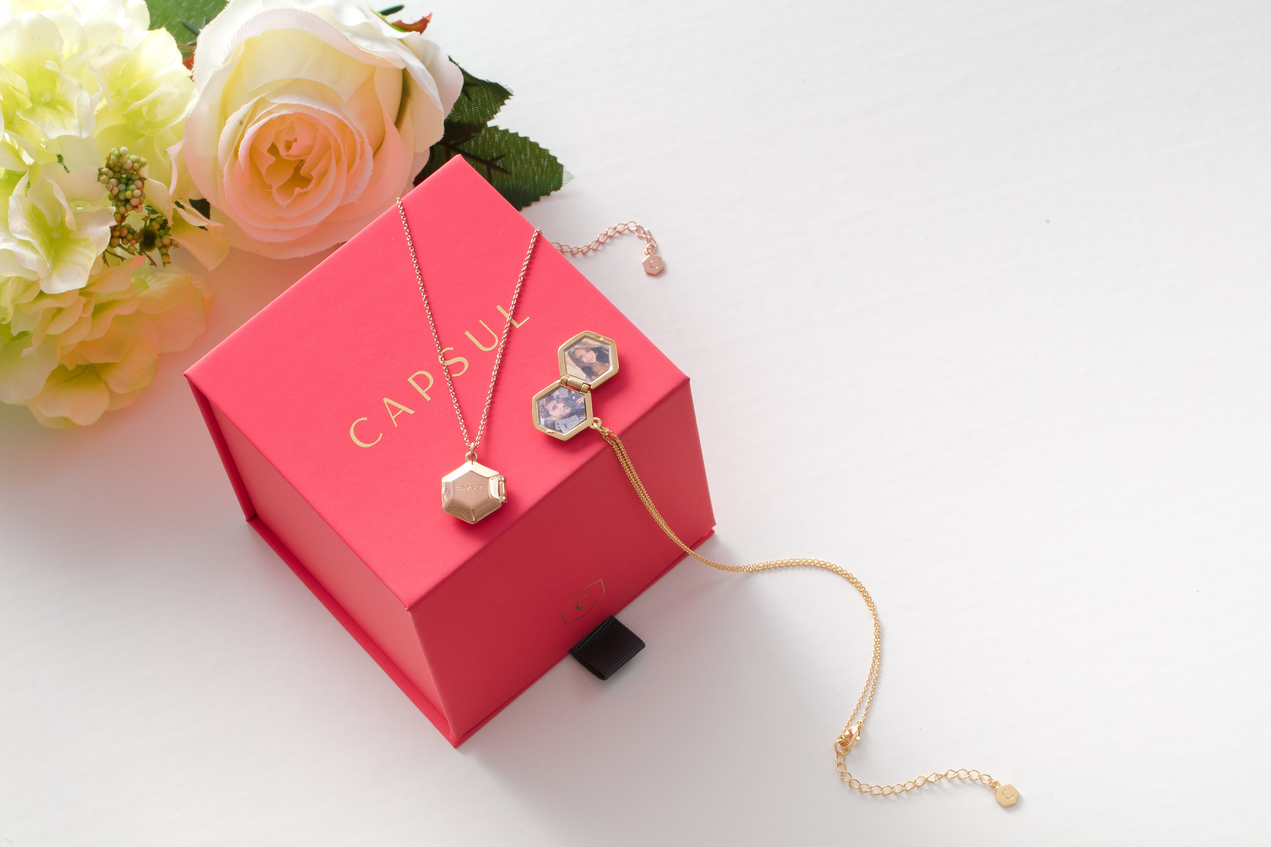 Capsul Locket Necklace: Keep photos of your loved ones close with the vintage locket made modern. We love these for couples who do long distance. They also make a great gift for new moms!