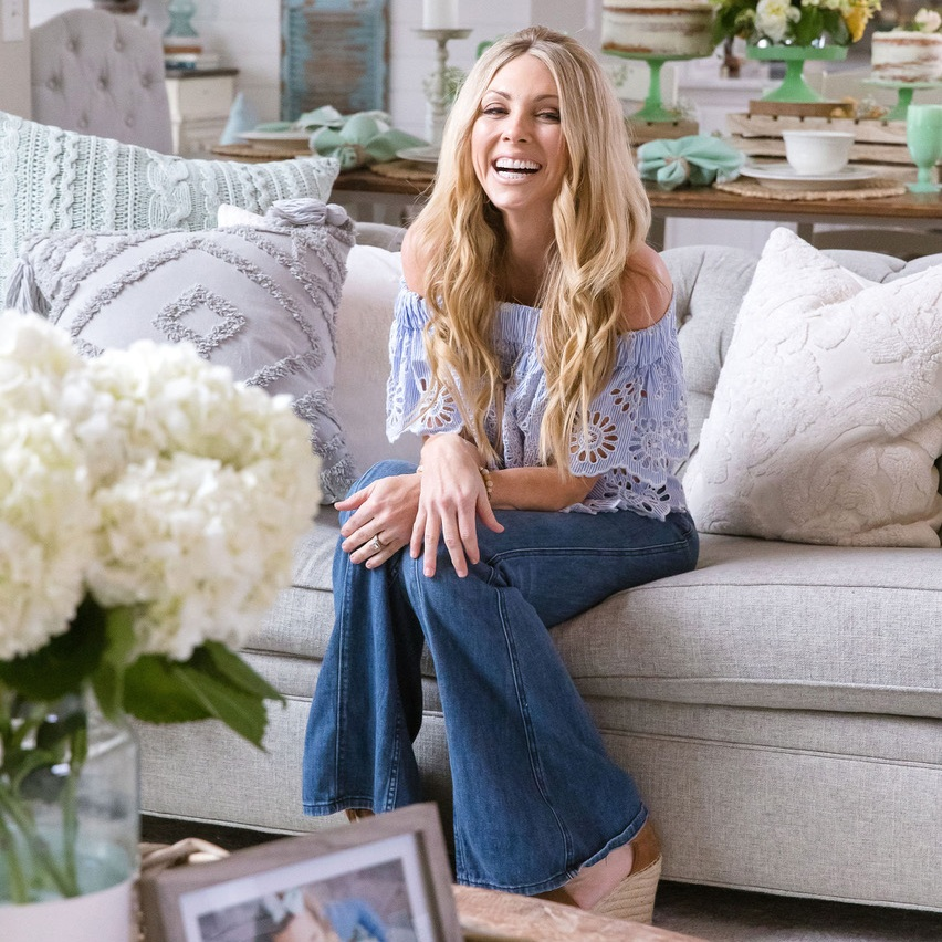 """Jenny Reimold   As the mother of seven children, high profile designer and former publicist, Jenny Reimold, designs functional spaces for the every day family. Following a recent move to Nashville with her husband, Nolan, a former veteran Orioles outfielder, Jenny's home was filmed as the """"Dream Home"""" for Property Brothers. The publicity generated from that experience led to design projects with high profile celebrity clients, a writing contract with HGTV, a full feature in Parents Magazine, multiple articles in House Beautiful and media projects with Good Morning America, People and SELF Magazine. Jenny is currently HomeGood's national """"Style Expert"""" but most importantly, uses her platform for adoption and foster care advocacy. As an adoptive parent, she volunteers to create cost free bedrooms for children in foster care and hopes that by sharing their family story, other families will open their hearts to adoption and foster care."""