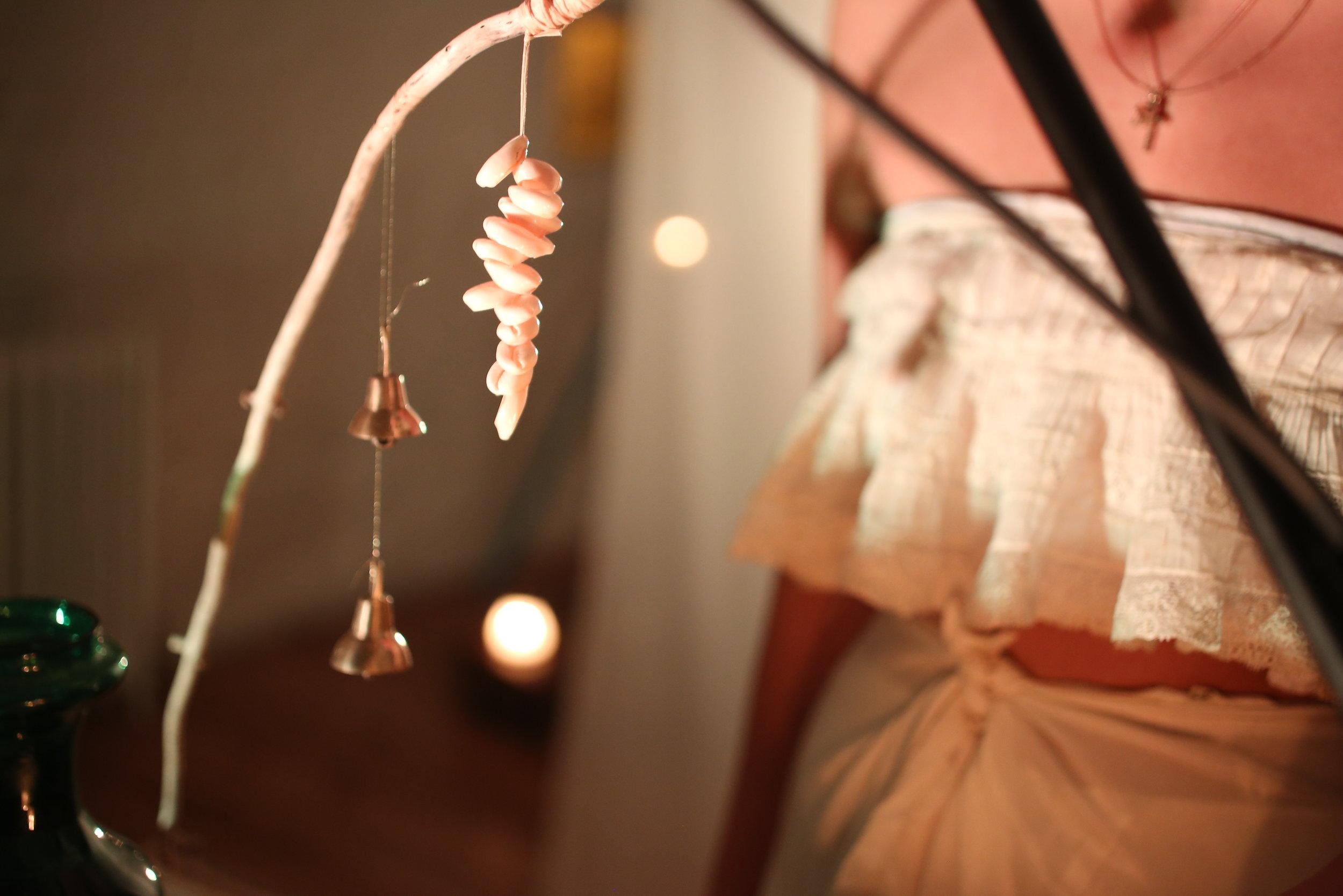 Cowrie shells, bells, Portugese lace