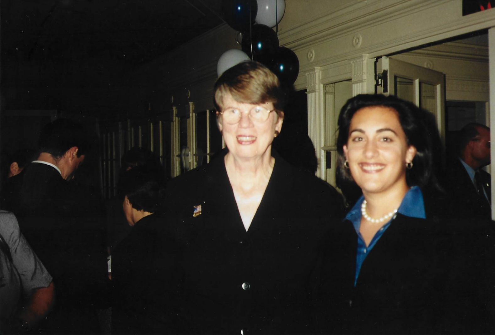 Maya poses with Attorney General Janet Reno after receiving the Attorney General's Award for Exceptional Service in 2000 -