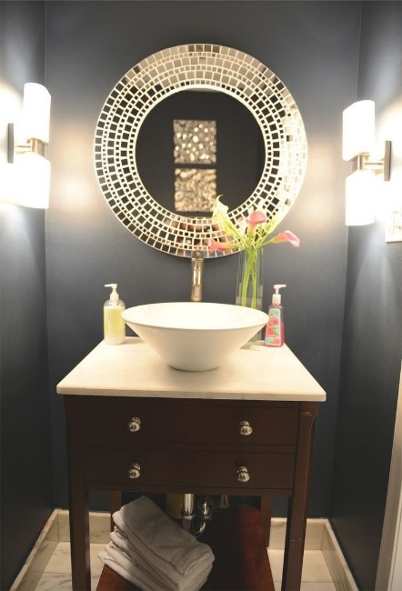 Elegance - This picture shows how you can make a half-bath become a statement maker. This bathroom shows a darker paint color with task lighting that accentuates the mirror that makes you go wow! when you enter.  Beautiful!