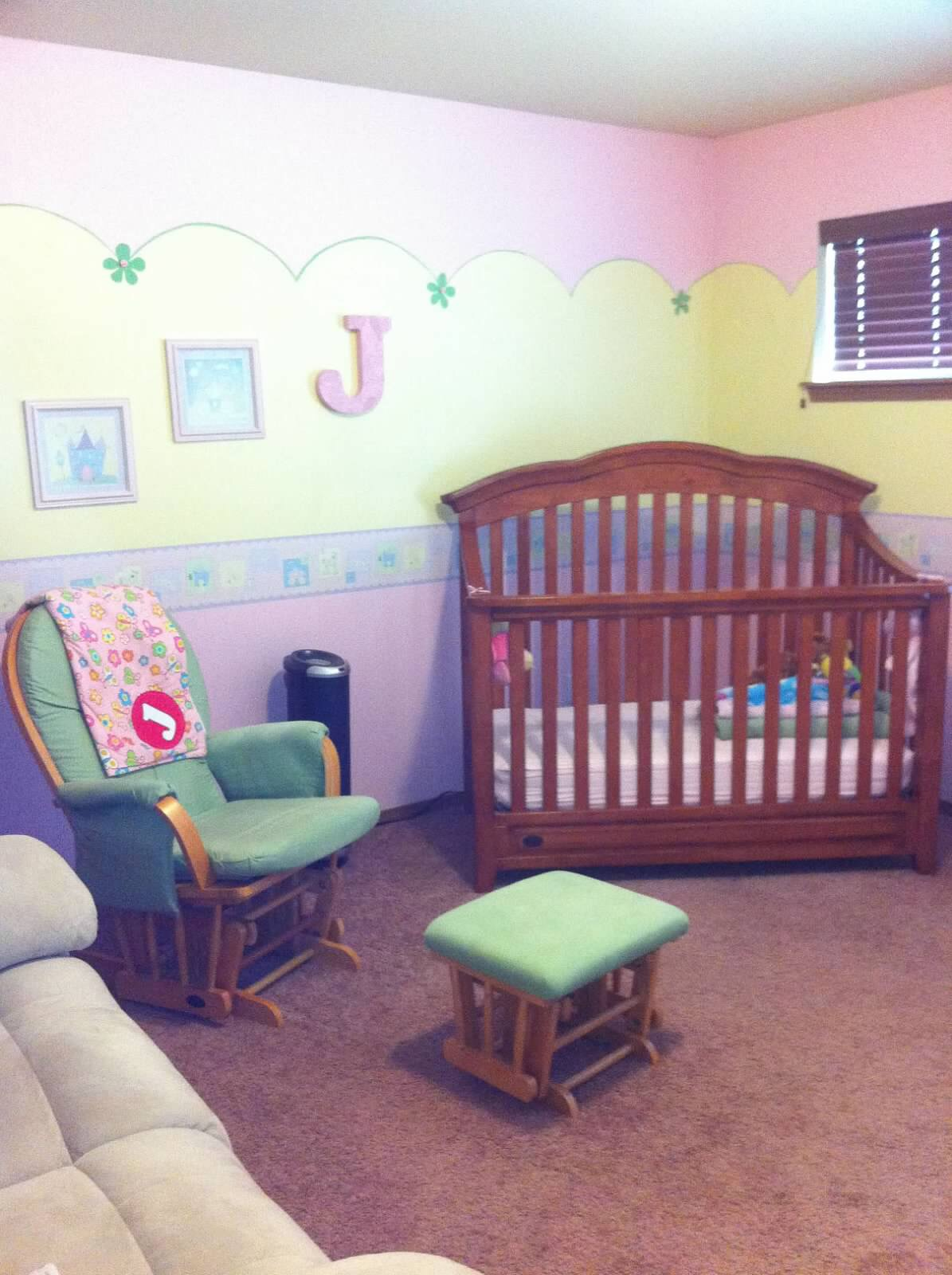 My baby girl... - Here you see for my daughter's nursery I went with pink and yellow with green as an accent. The wallpaper border allows even more accent colors to be chosen if I desired.