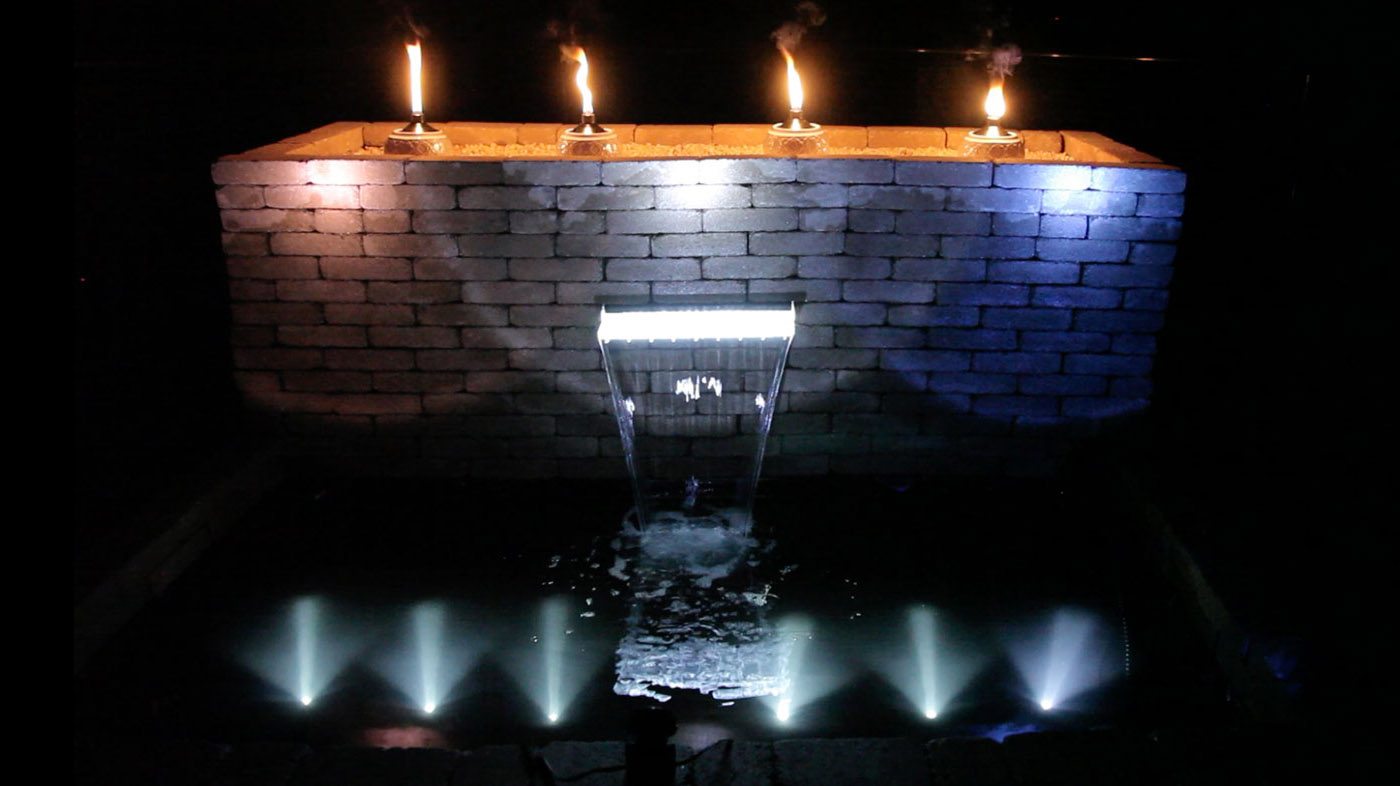 Lit Spillway Above Ground Pond