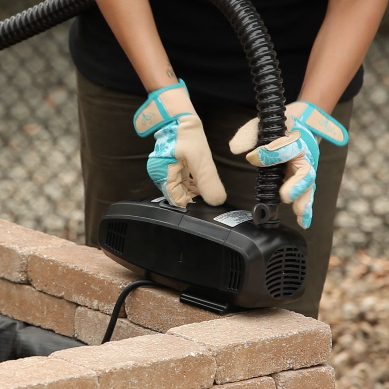Step 7 - Once you've completed building your water feature, place the pump in your water basin.
